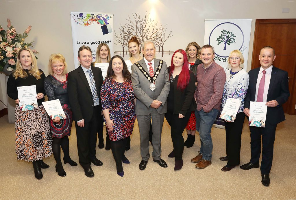 12 Northern Ireland bloggers received certificates for completing a six-week course at Lisburn City Library. Delivered by TrainingMatchmaker.com and backed by Libraries NI the course introduced new and intermediate bloggers to the tools and techniques necessary to become a successful presence in the online world. Mayor of Lisburn and Castlereagh City Council, Councillor Uel Mackin, presented certificates to all participants at Civic Headquarters, Lagan Valley Island, Lisburn on December 20. . Pictured Front row: Fiona Taylor (participant), Lynda Willis (participant), Jim O'Hagan (CEO Libraries NI), Christine Watson Chartered Marketer at Watson and Co Chartered Marketing (founder of TrainingMatchmaker.com), Councillor Uel Mackin (Mayor of Lisburn & Castlereagh City Council), Tina Calder (TrainingMatchmaker.com trainer Excalibur Press), Ciaran Connolly (TrainingMatchmaker.com trainer Profile Tree), Mary Jane Burns (participant) and David Archer (participant). Back row: Karen McIlwee (participant), Clare Flynn (participant) and Jill McDowell (participant).